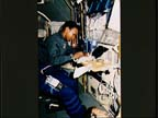 Astronaut Performing Fluid Therapy System Experiment On Board Spacelab J (SL-J)