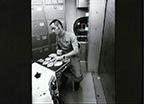 Astronaut Robert Crippen Simulates Preparation of Skylab Meal