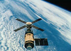 Skylab in Earth orbit as seen from the Command and Service Module (CSM)