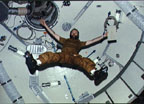 Skylab 4 Commander, Gerald P. Carr, floating in Skylab