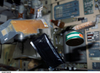 Food Cans and Packets Floating Freely On Board ISS