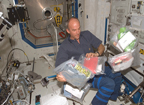 Unpacking Food Bags on ISS