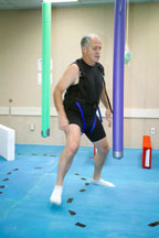 Crewmember John Phillips Navigates Obstacle Course During Mobility BDC