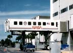 Crew Transport Vehicle (CTV) Docked to the Baseline Data Collection Facility at Kennedy Space Center