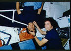 STS-34 Crewmembers Conduct Experiment on Shuttle Middeck